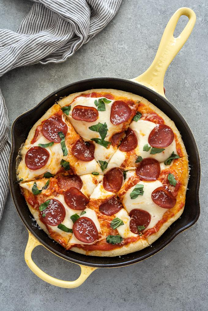 Focaccia bread pizza sliced in skillet
