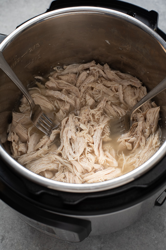 Forks shredding Instant Pot shredded chicken breast
