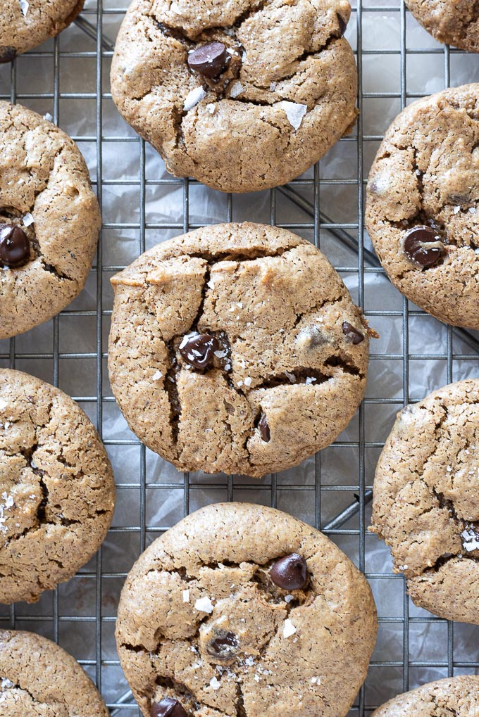 Almond butter chocolate chip cookies on a wire rack