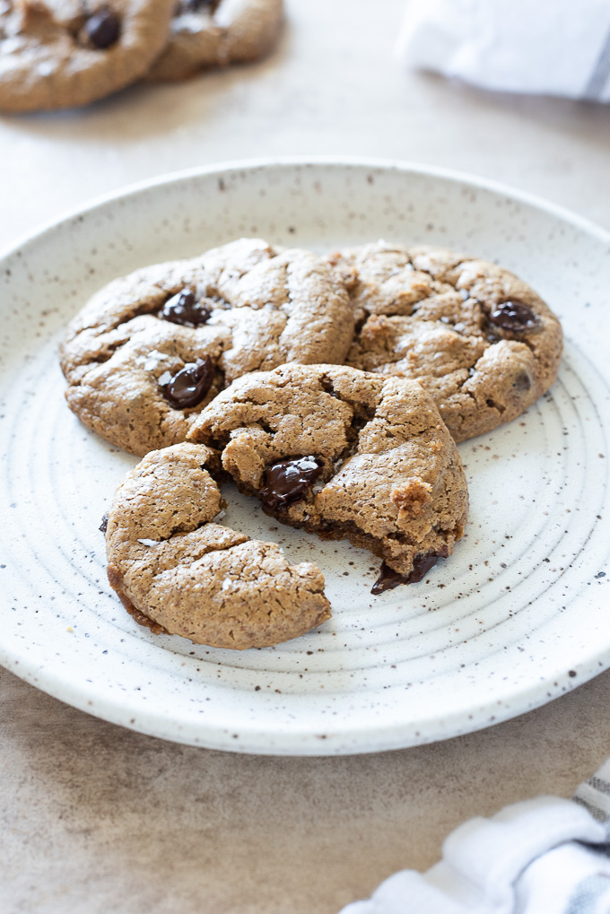 Almond butter cookie pulled in half with melted chocolate chip oozing