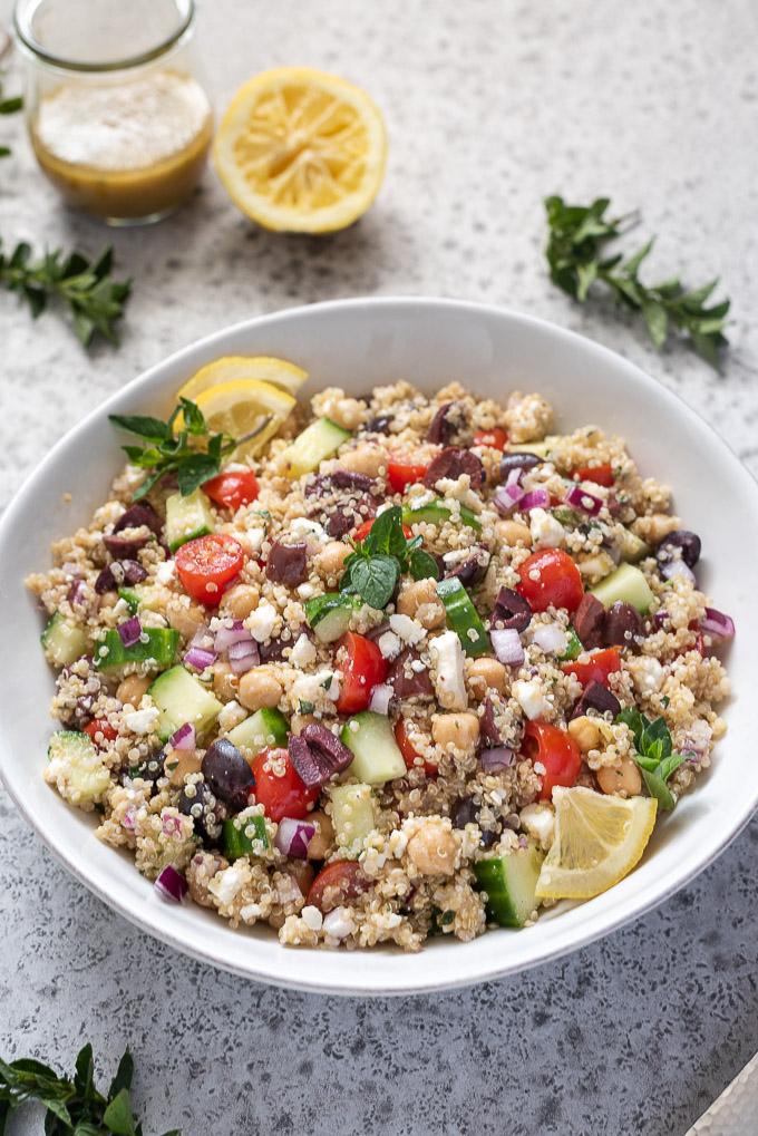 Greek quinoa salad with lemon slices and oregano on top