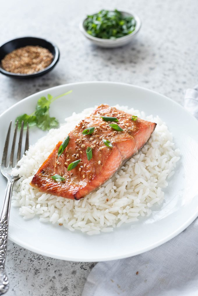 Miso salmon over rice on a plate