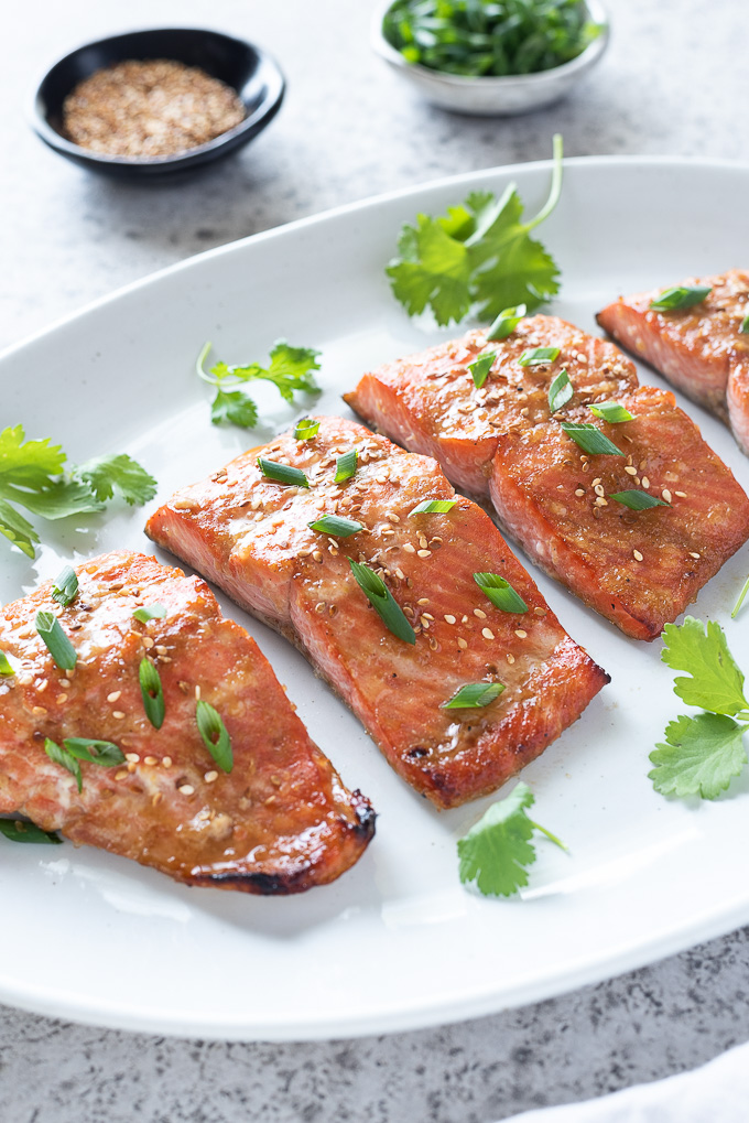 Miso salmon on a serving platter with garnishes alongside