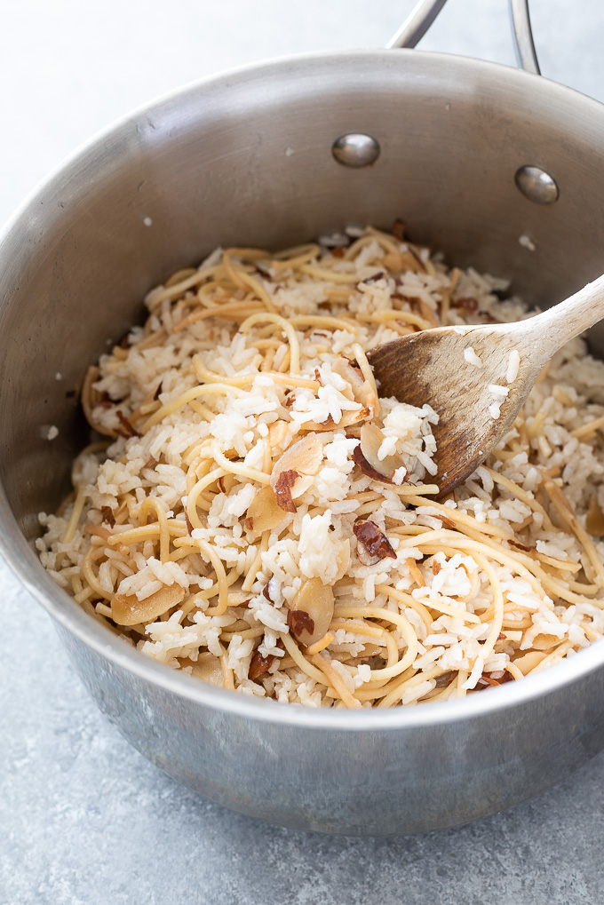 Wooden spoon in a pot of rice pilaf