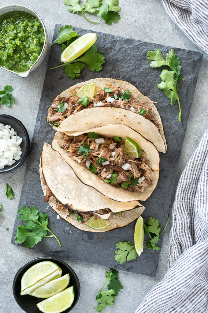 Pork carnitas tacos on a serving plate