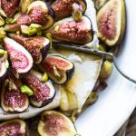 Brie cheese topped with honey and figs.