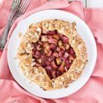 Rhubarb galette on a white round plate