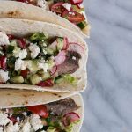 Three steak tacos with radish slaw