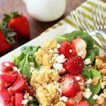Strawberry rhubarb salad on a white plate.