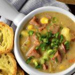 White ramekin of sweet corn and kielbasa soup.