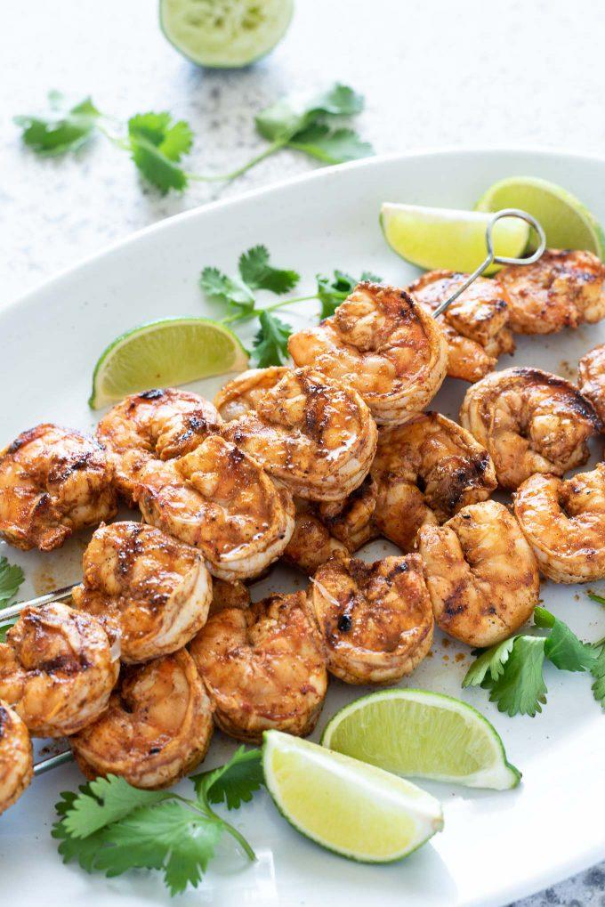 Chili lime grilled shrimp skewers on a serving platter
