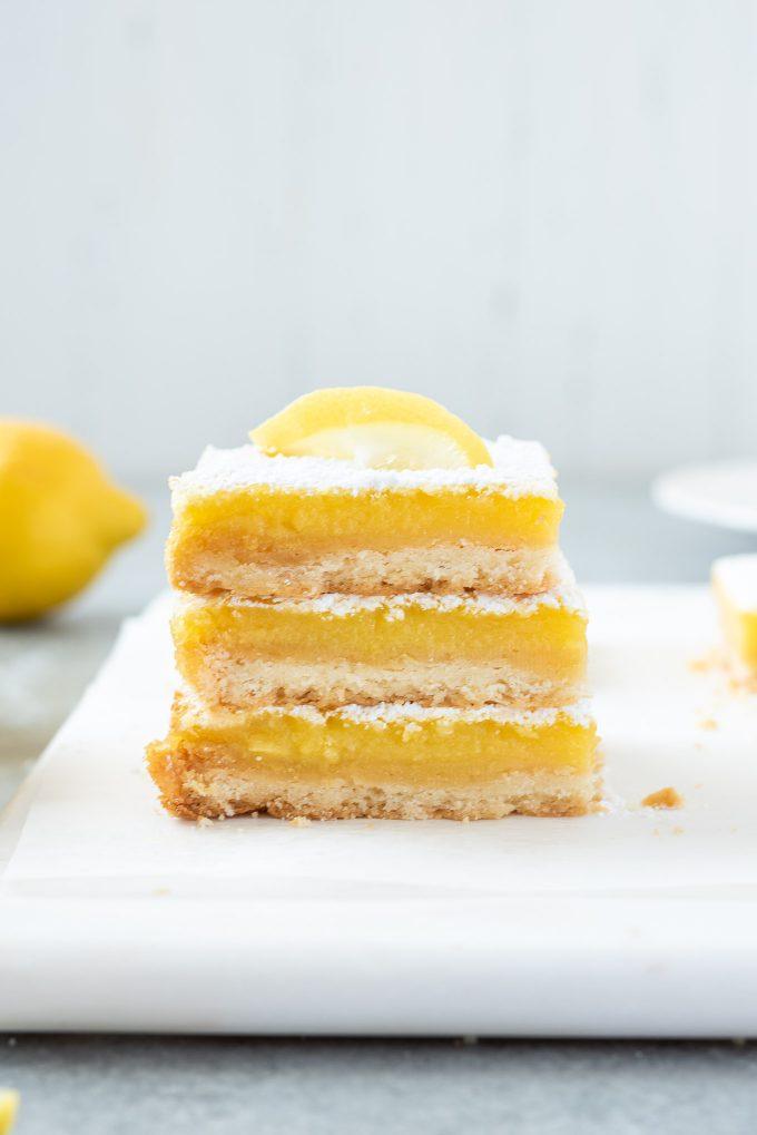 Stack of lemon bars on a platter