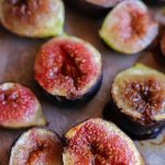 Maple roasted figs scattered on a baking tray.