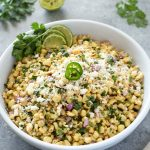 Mexican corn salad in a bowl with jalapeno on top