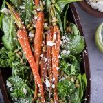 Overhead view of a roasted carrot spinach salad.