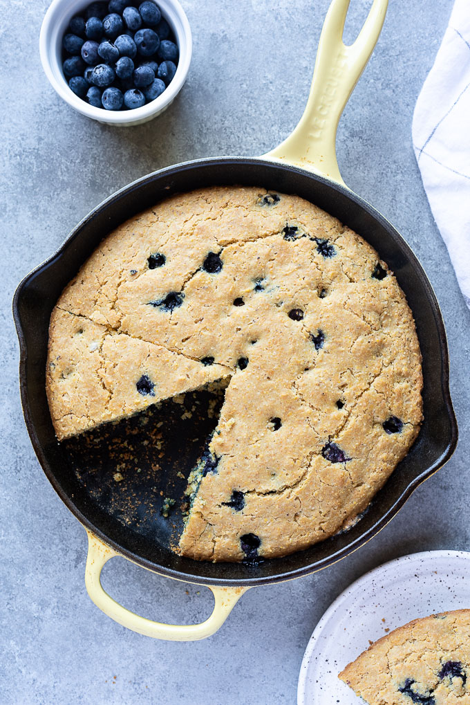 Skillet Blueberry Cornbread with wedge removed