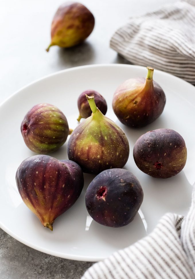 Fresh figs on a white plate
