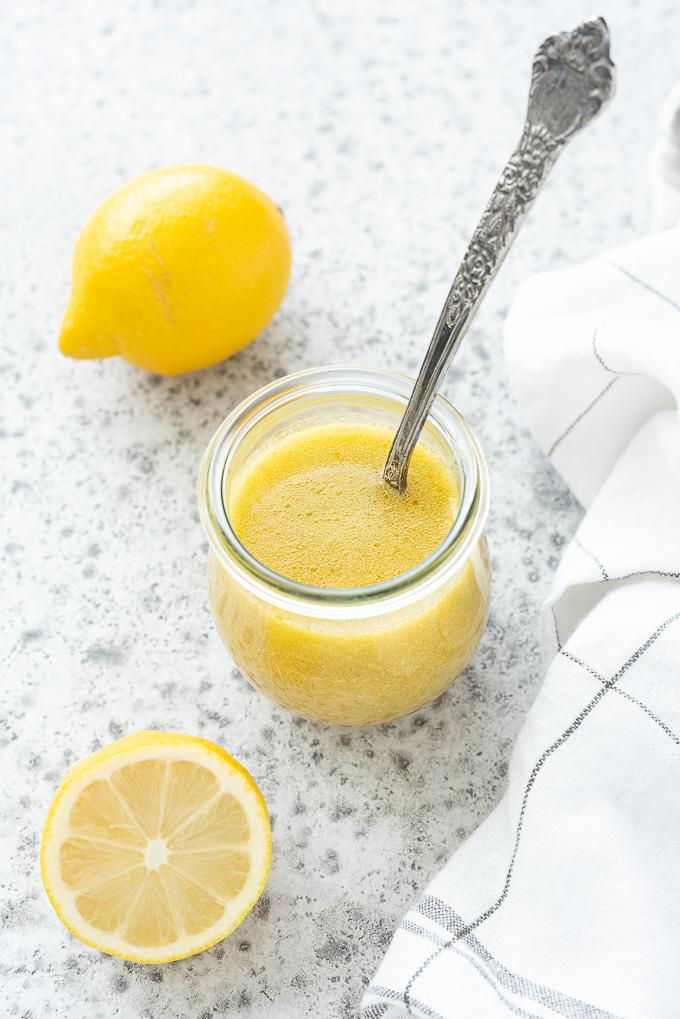 Spoon in a jar of lemon vinaigrette