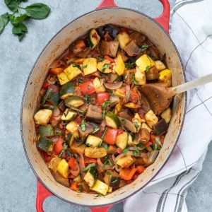 Ratatouille in a Dutch oven with basil on top