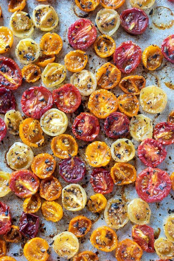 Roasted cherry tomatoes on a sheet pan
