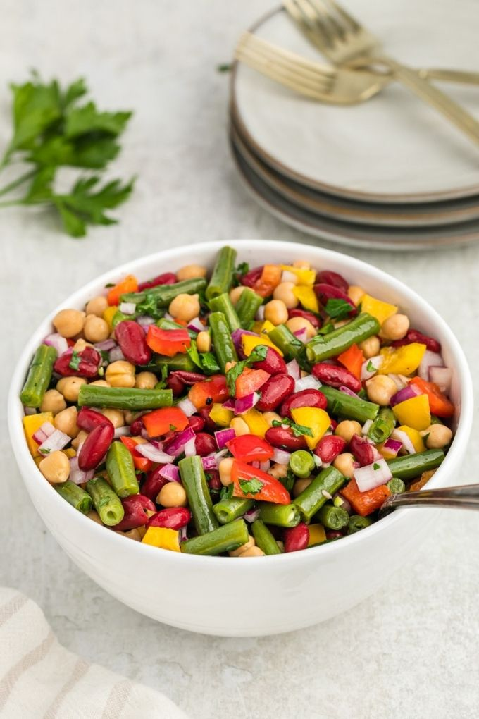 Bowl with three bean salad and parsley on top