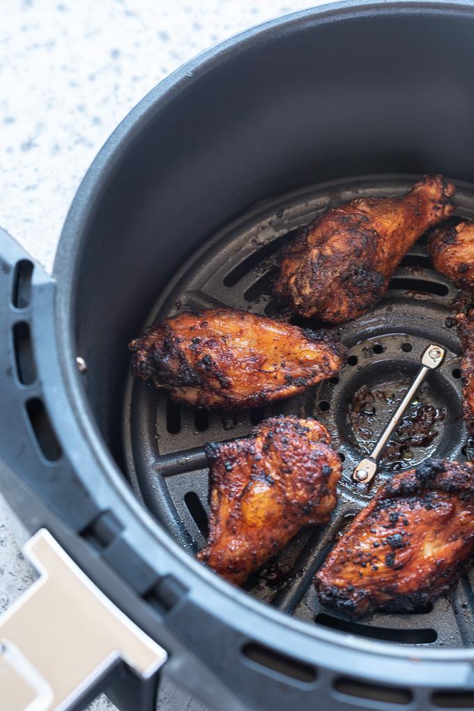 Air fryer chicken wings in air fryer basket