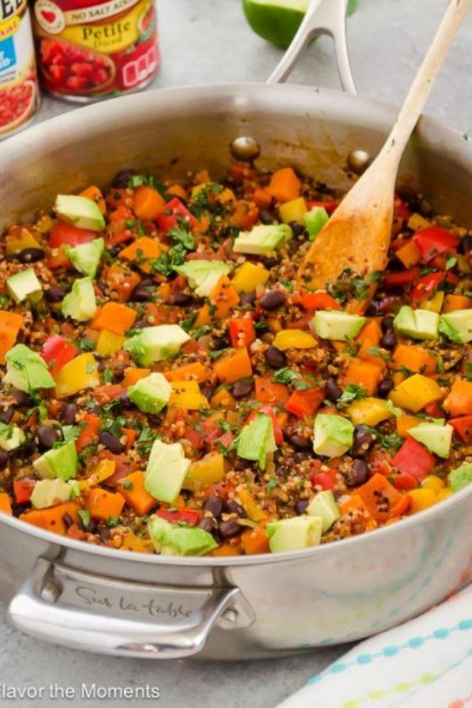 Wooden spoon digging into Mexican quinoa