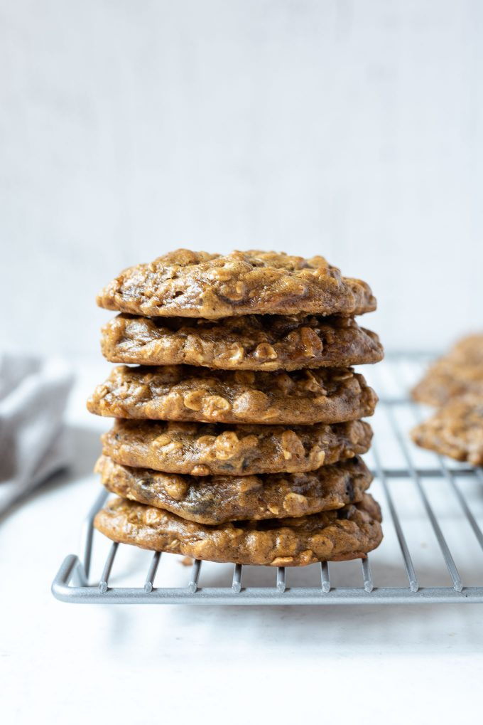 Stack of peanut butter banana cookies on a wire rack