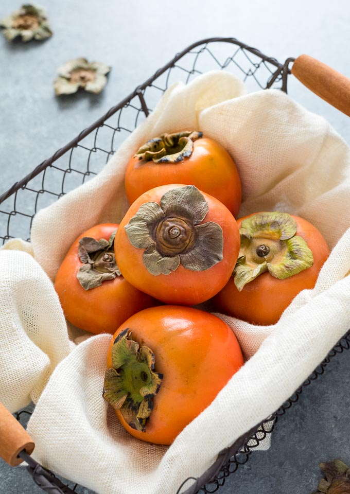 Persimmon in a linen lined basket